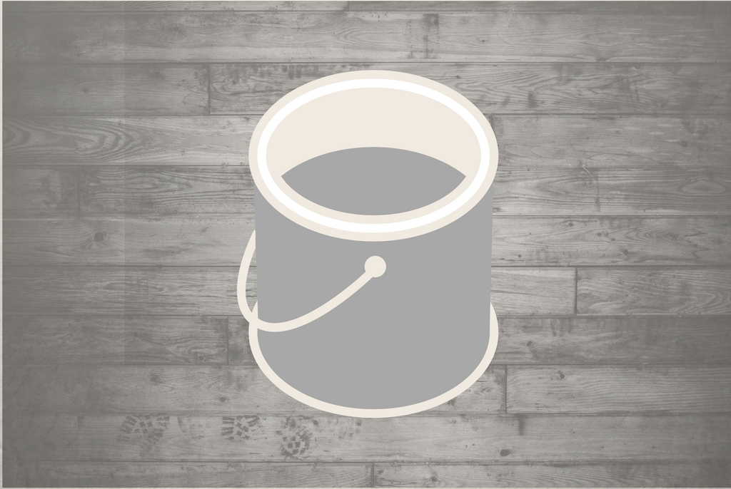 Outline of a white and grey paint bucket against a wooden background