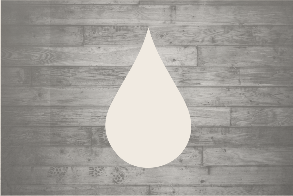 Outline of a white rain drop against a wooden background
