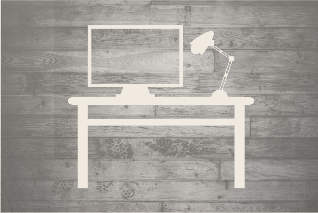 Outline of a white desk against a wooden background